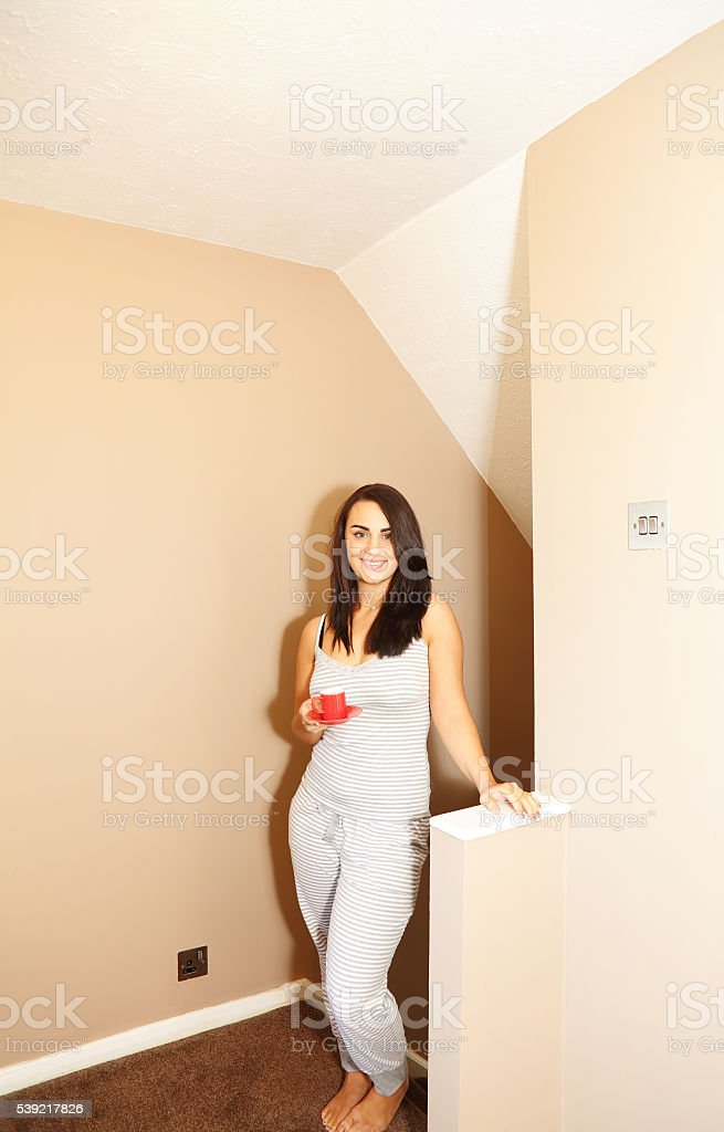 female bring her hot chocolate to bed stock photo