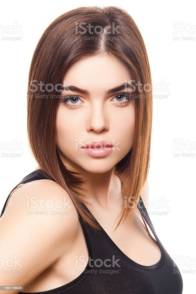 Female brunette posing and looking into the camera stock photo