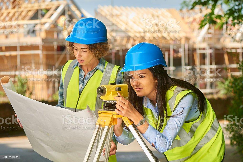 female building surveyors stock photo