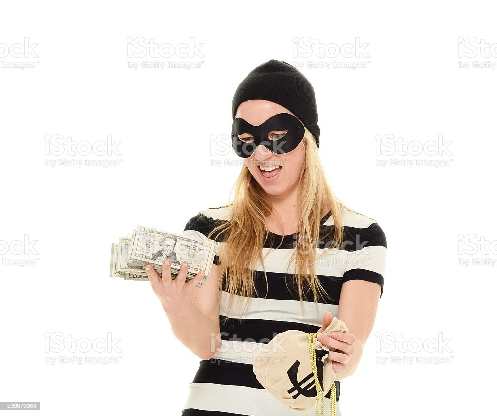 Female burglar holding money stock photo