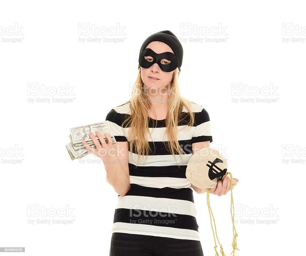Female burglar holding money stock photo