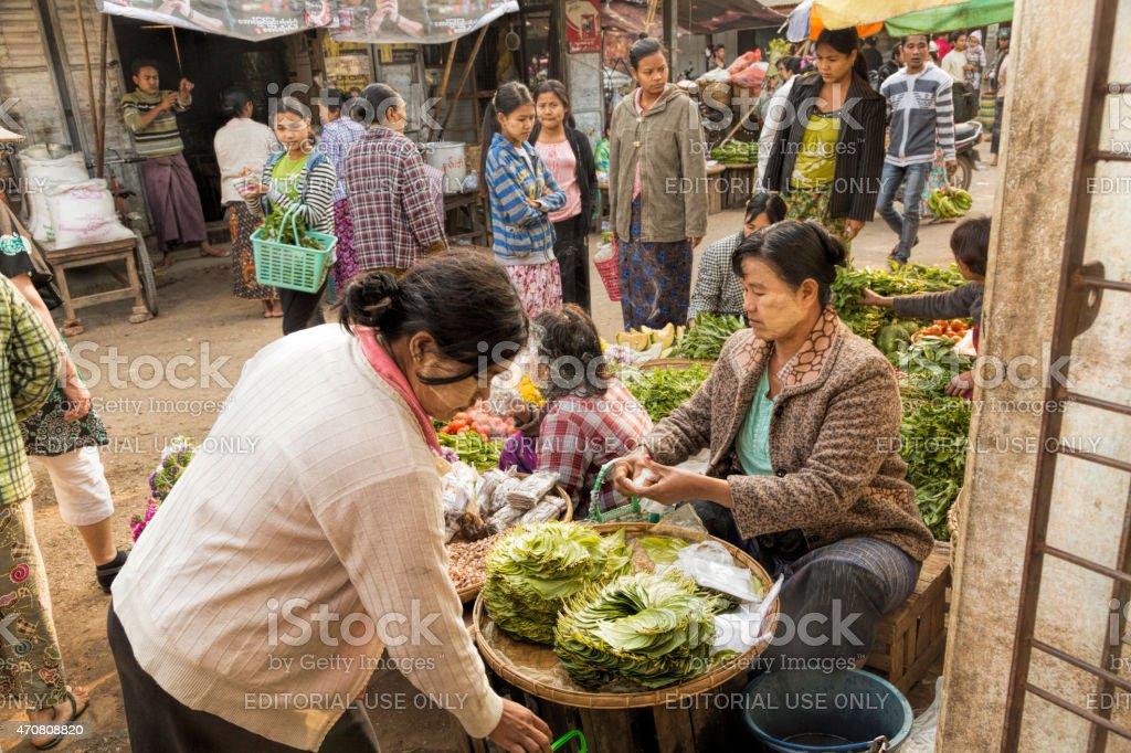 Female Burmese vendor  selling betel nut at Asian market. Myanmar. stock photo