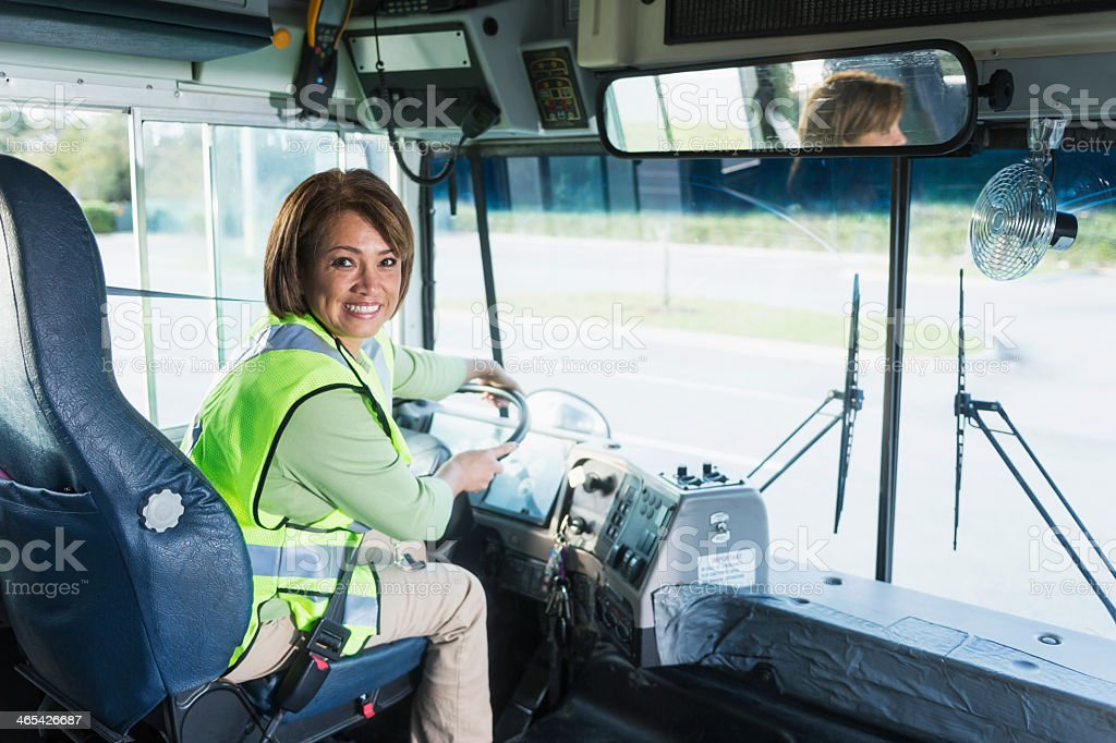 Female bus driver stock photo