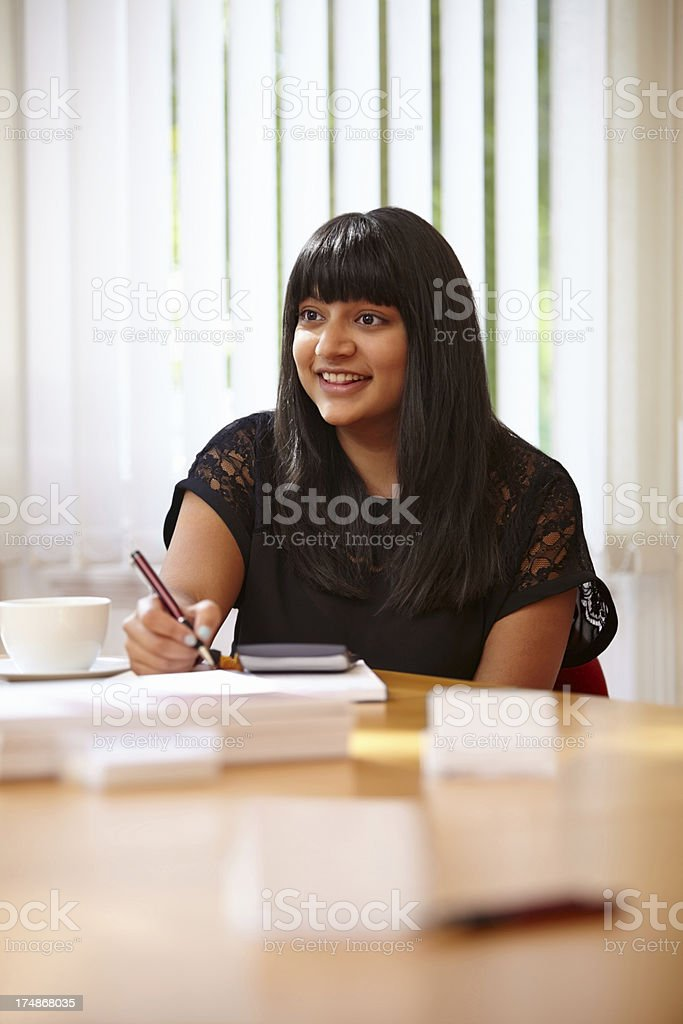 Female business executive working in office royalty-free stock photo