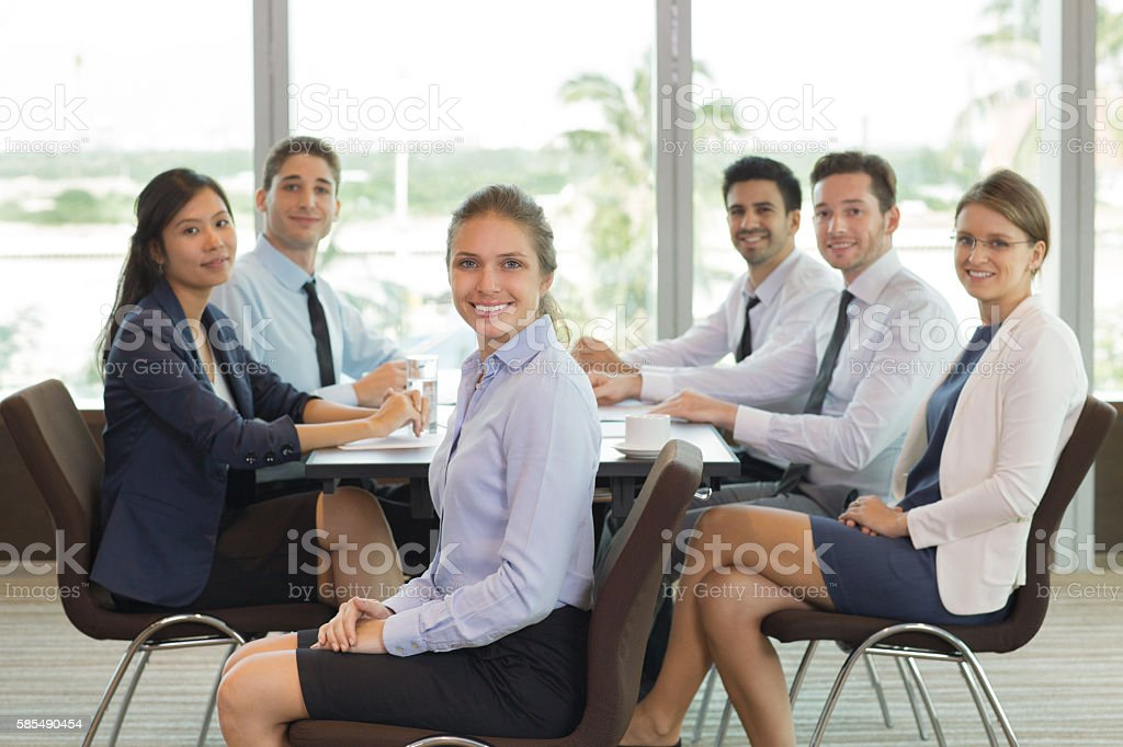 Female Business Leader and Team in Office stock photo