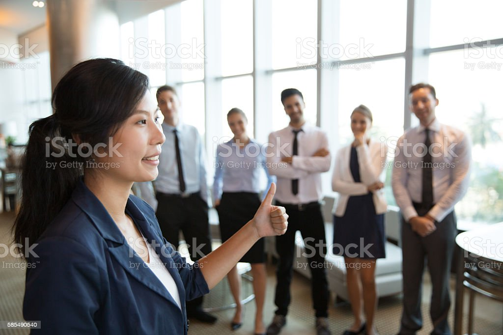 Female Business Leader with Thumb up stock photo