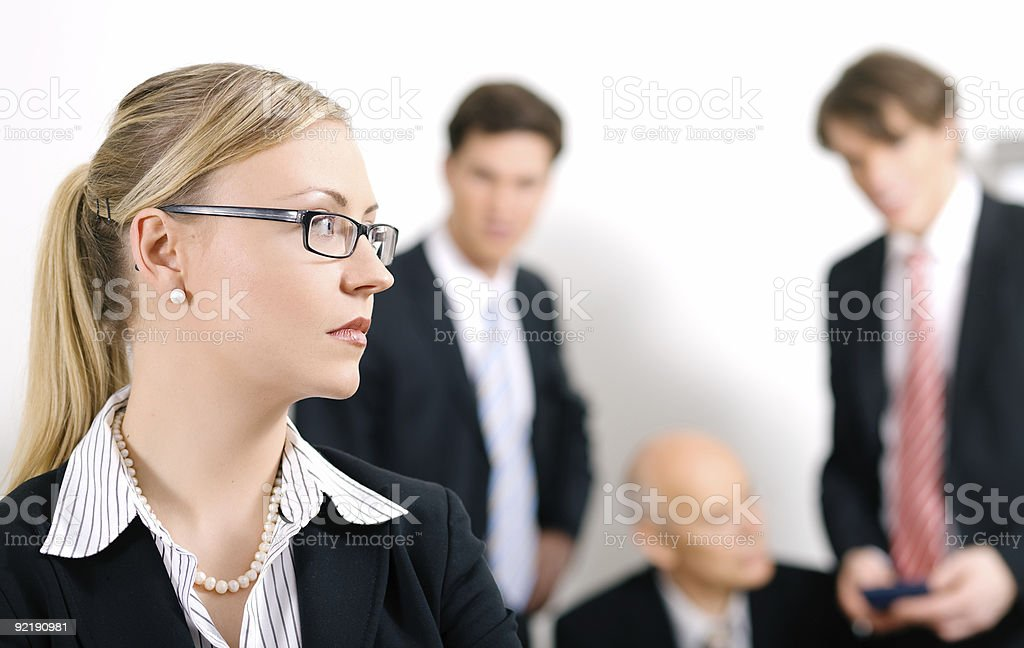 Female businesswoman overhears conversation of colleagues stock photo
