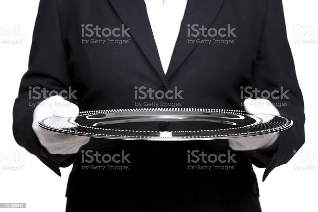Female butler holding a silver tray isolated on white. stock photo