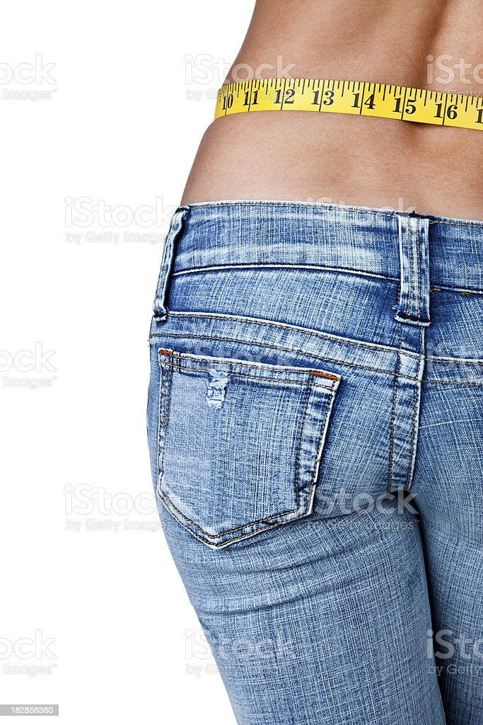 Female buttocks and measuring waist stock photo
