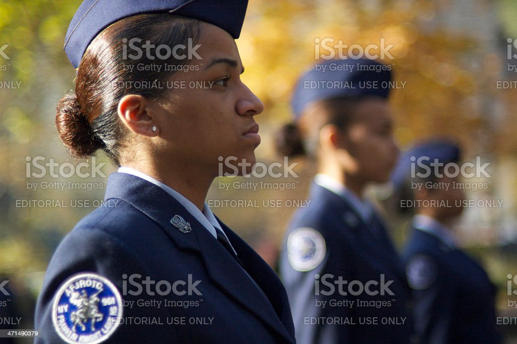 Female Cadets Stand Outdoors in Military Ceremony stock photo