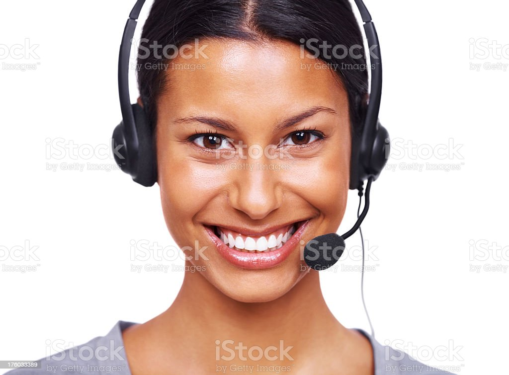 Female call centre employee wearing a headset against white stock photo