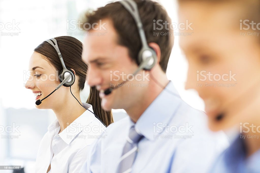 Female Call Centre Representative With Colleagues royalty-free stock photo