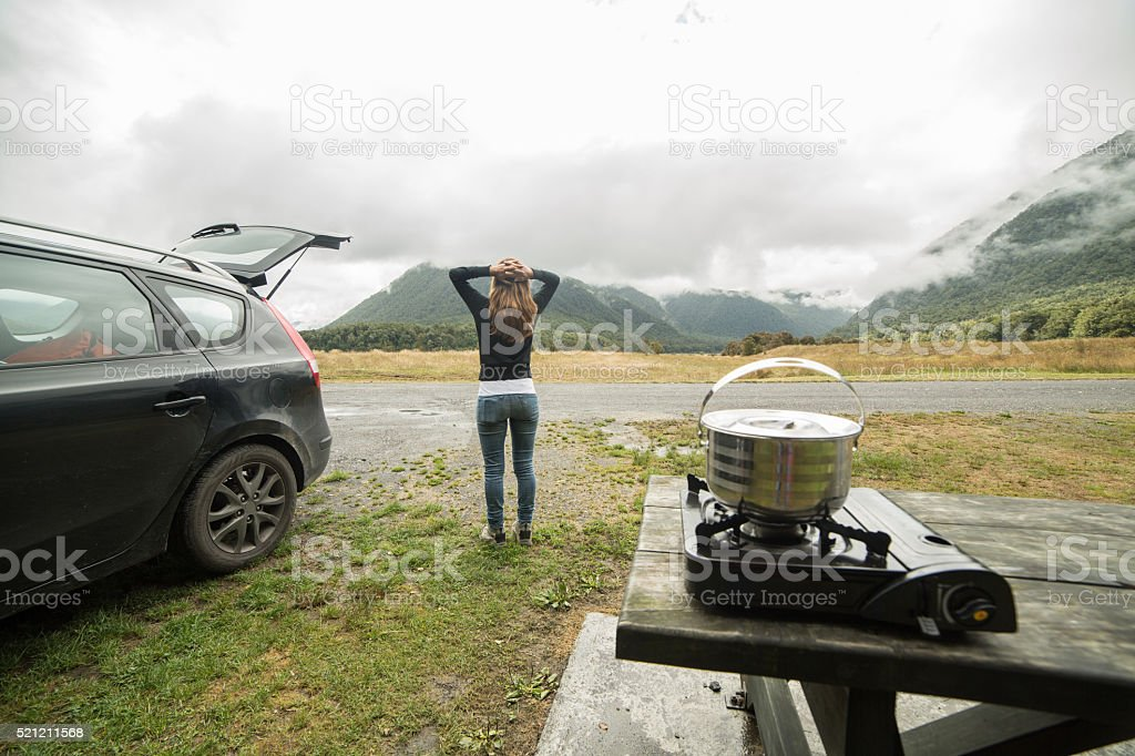 Female camps in a wilderness area, mountain background-New Zealand stock photo