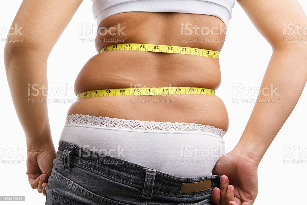 Female can not wearing her jeans anymore stock photo