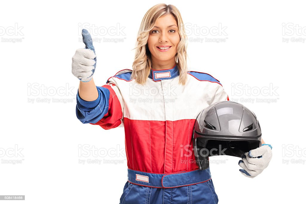 Female car racer giving a thumb up stock photo