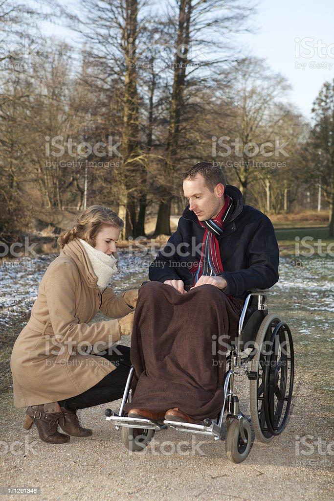 Female Caretaker Helping Disabled Man stock photo