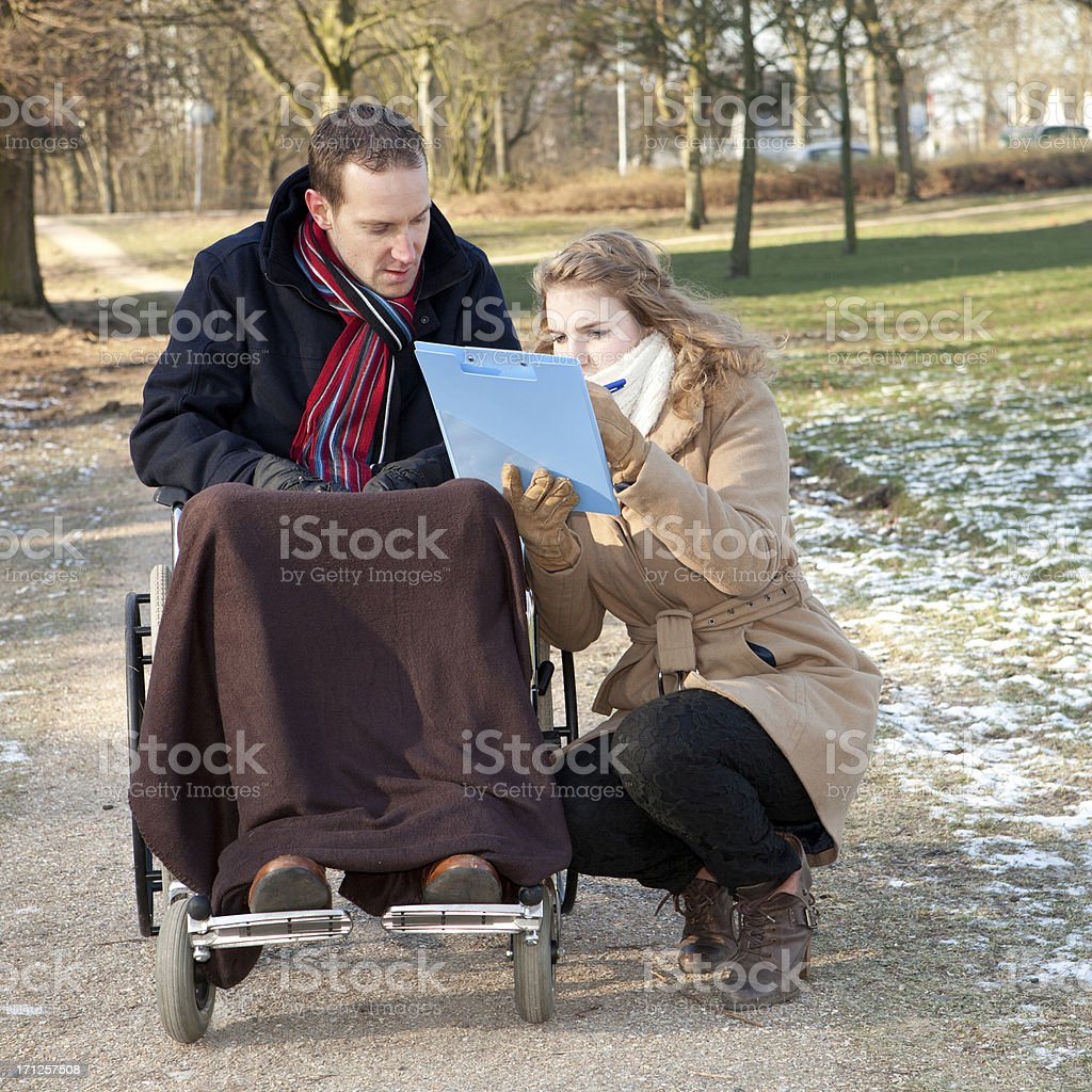 Female Caretaker With Man In Park stock photo
