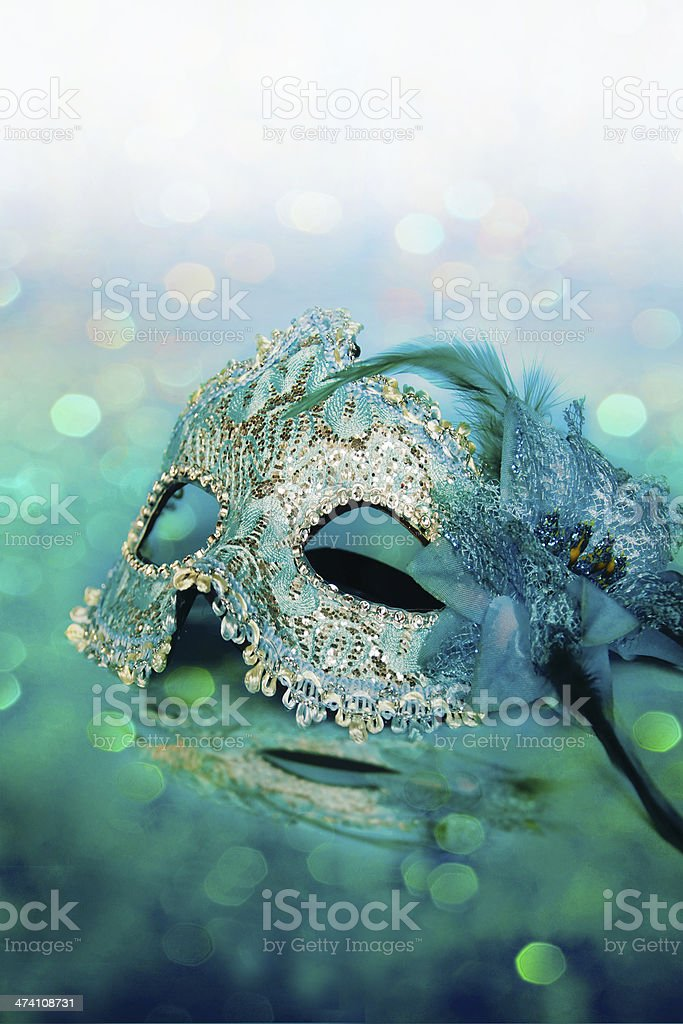Female carnival mask with shiny background. royalty-free stock photo