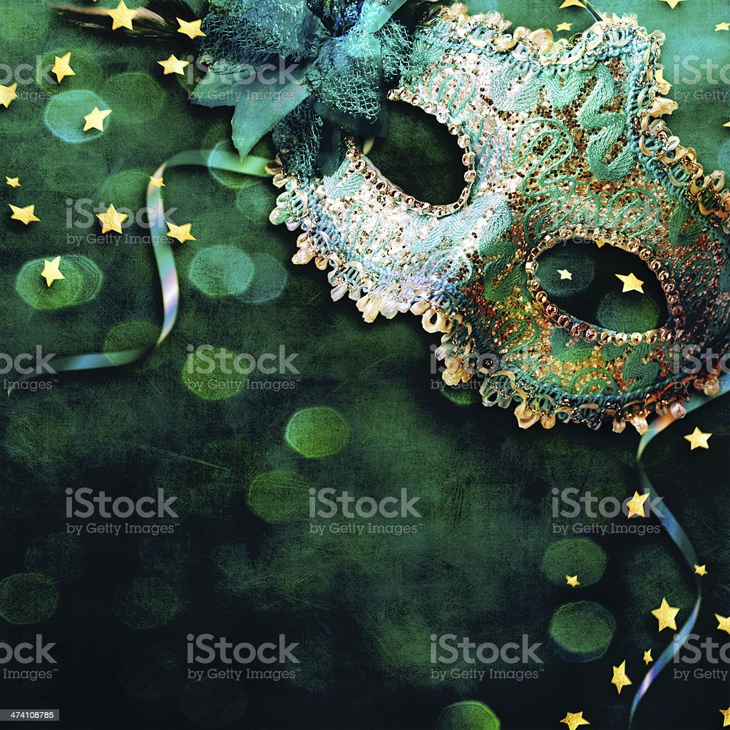 Female carnival mask with shiny background. stock photo