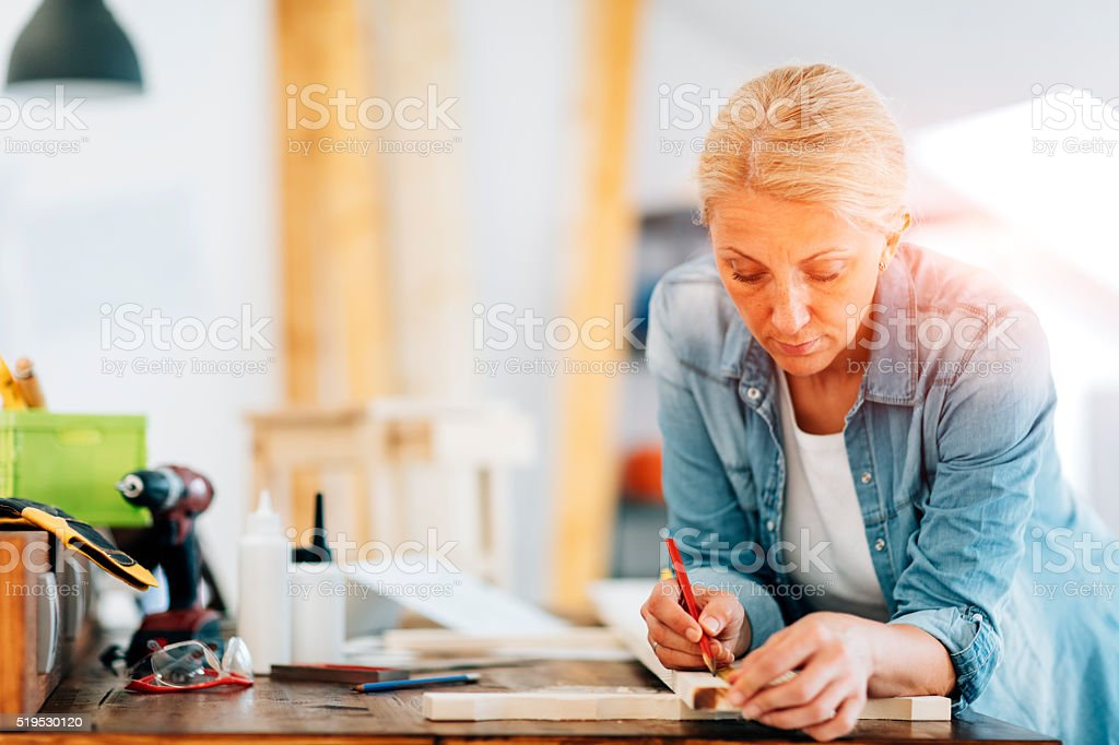 Female Carpenter At Work In Her Office. stock photo