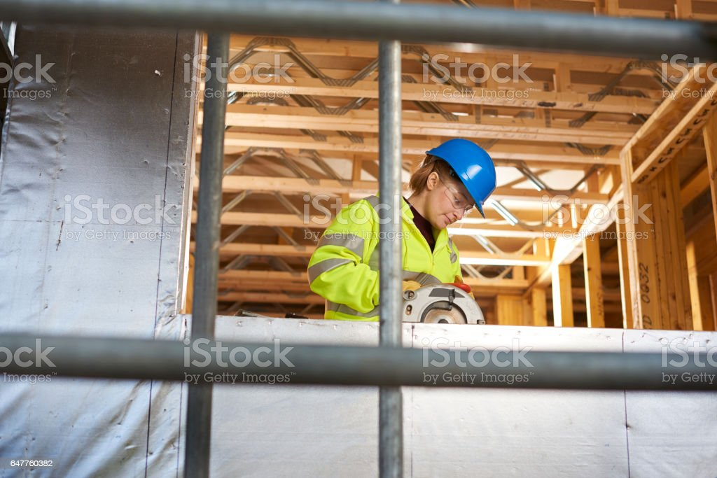 female carpenter on a building site stock photo