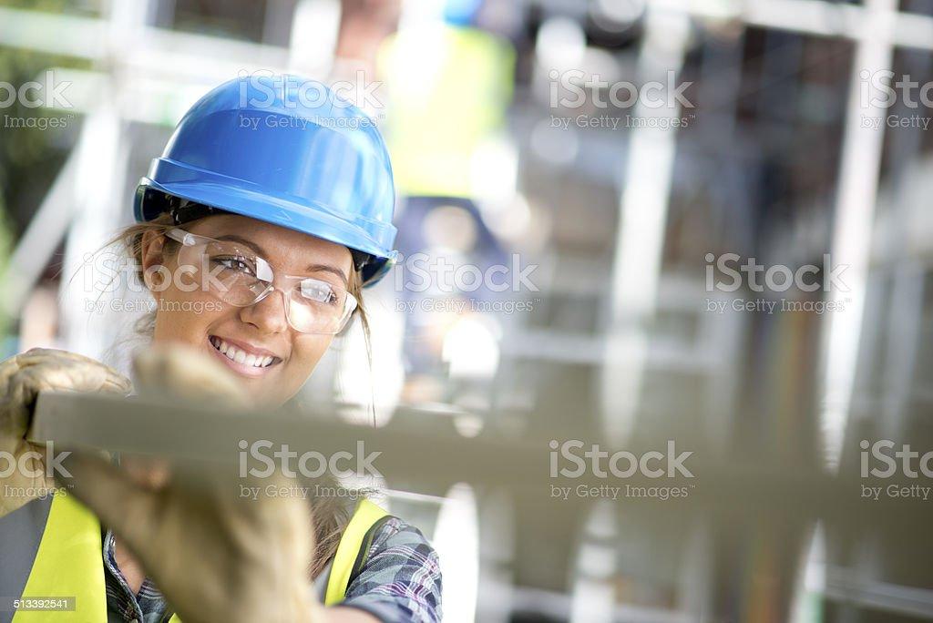 female carpenter on site stock photo
