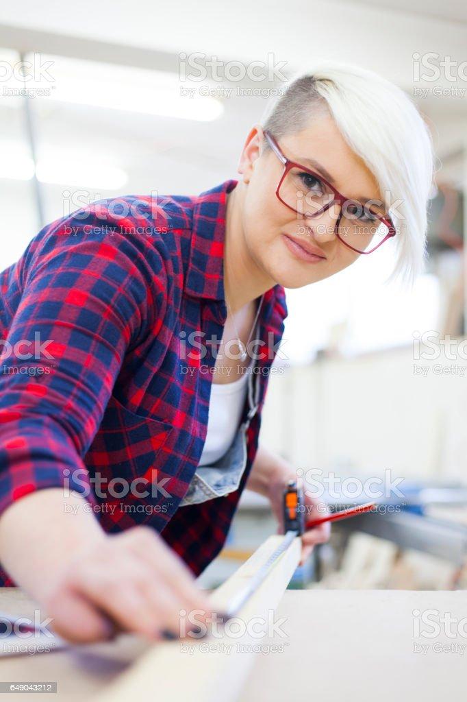 female carpenter stock photo