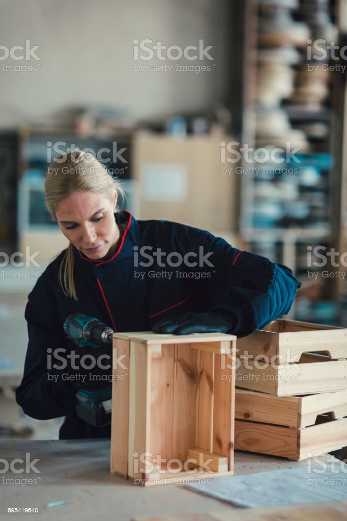 Female Carpenter Working In Her Workshop stock photo