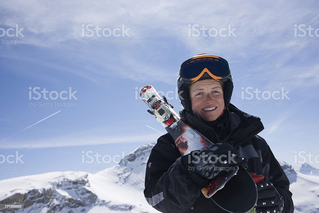 A female carrying her skis on a mountain royalty-free stock photo