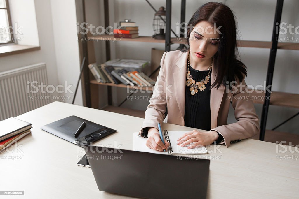 Female cartoonist drawing at office stock photo