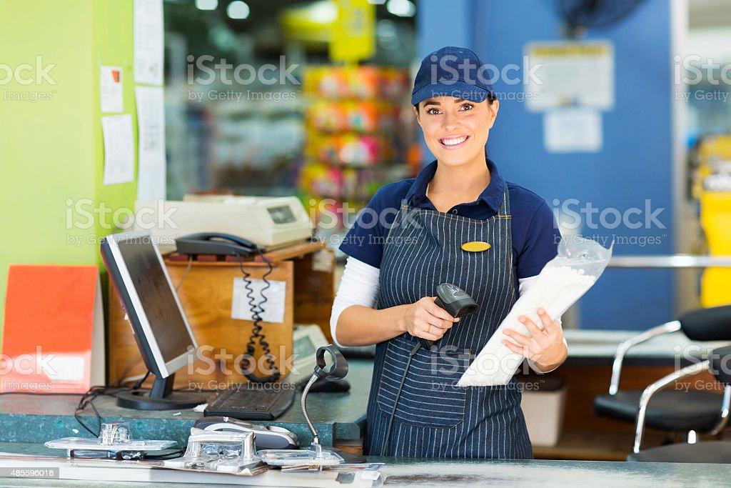 female cashier at hardware store stock photo