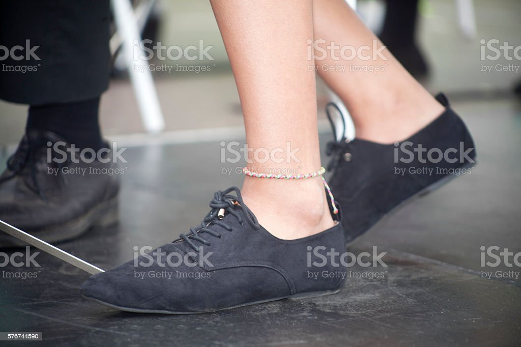 Female casual black lace shoes stock photo