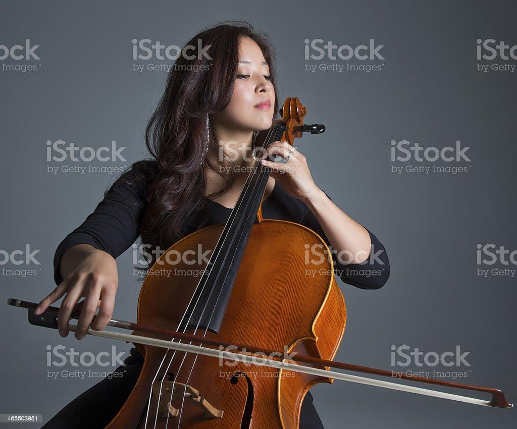 Female Cellist Playing Cello stock photo