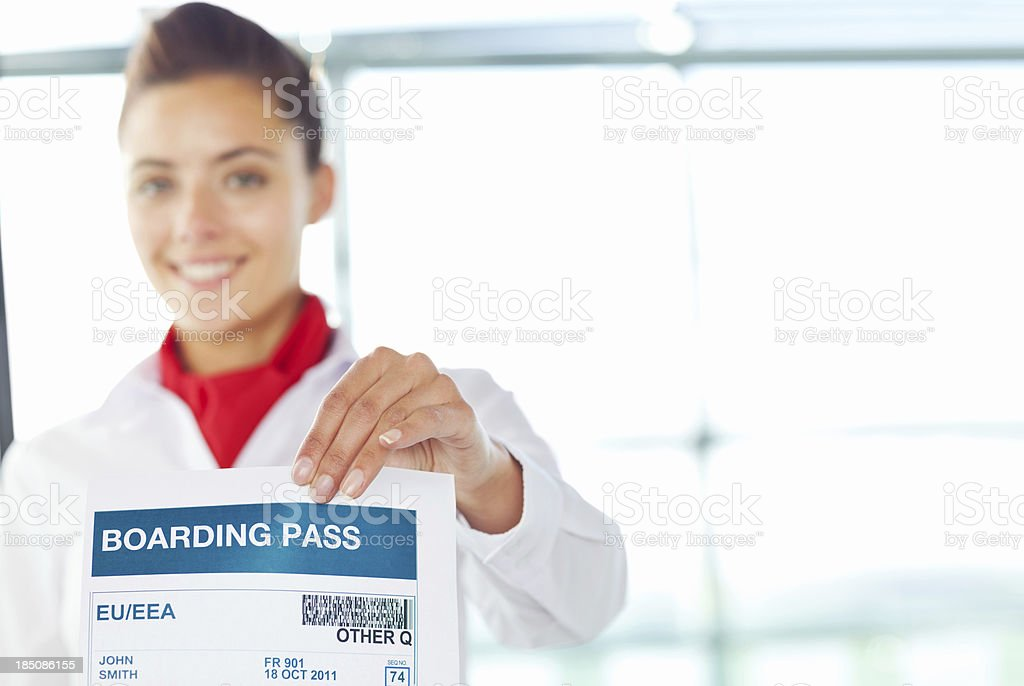 Female Check-In Attendant Holding Boarding Pass royalty-free stock photo