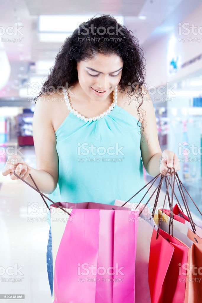 Female checking a shopping bag in the mall stock photo