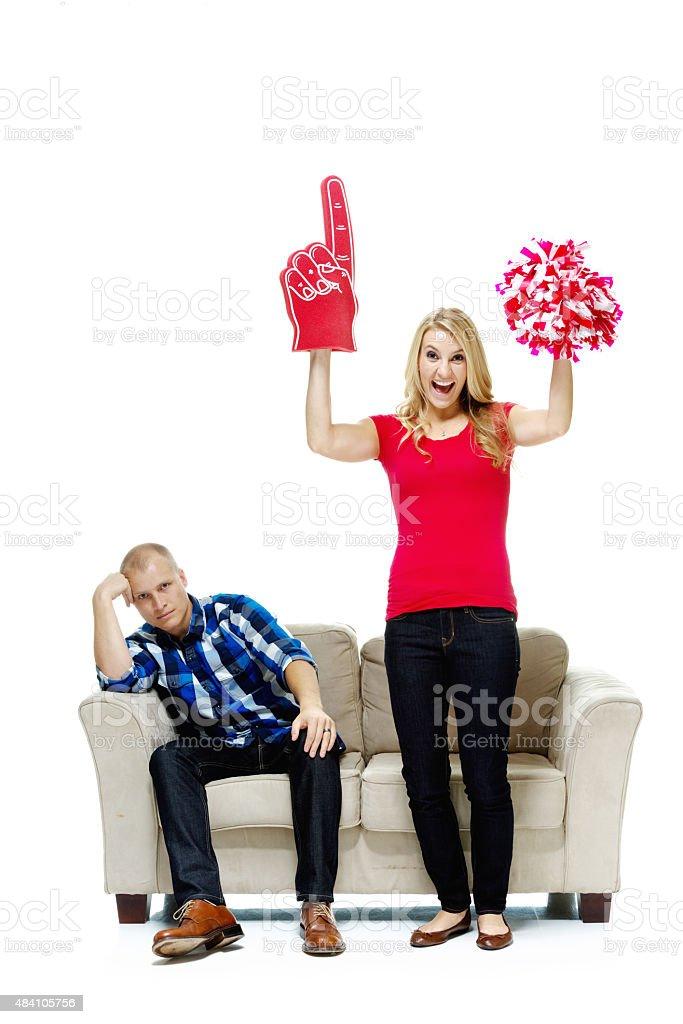 Female cheering while male upset stock photo