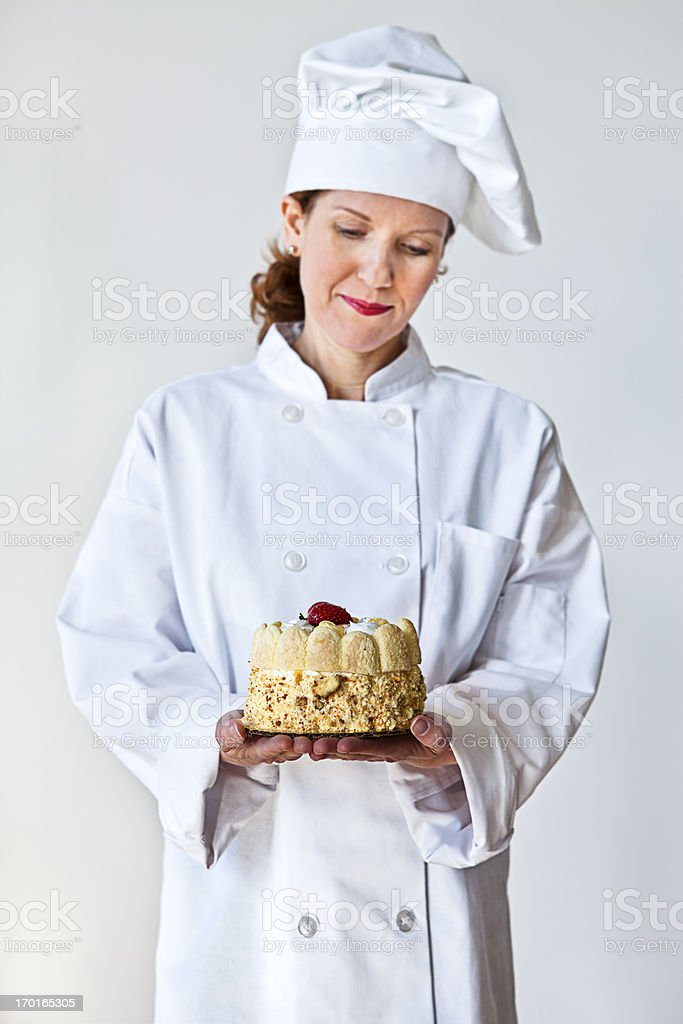 Female chef holding a cake stock photo