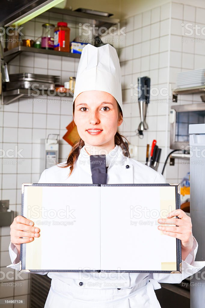 female chef holding blank menu royalty-free stock photo