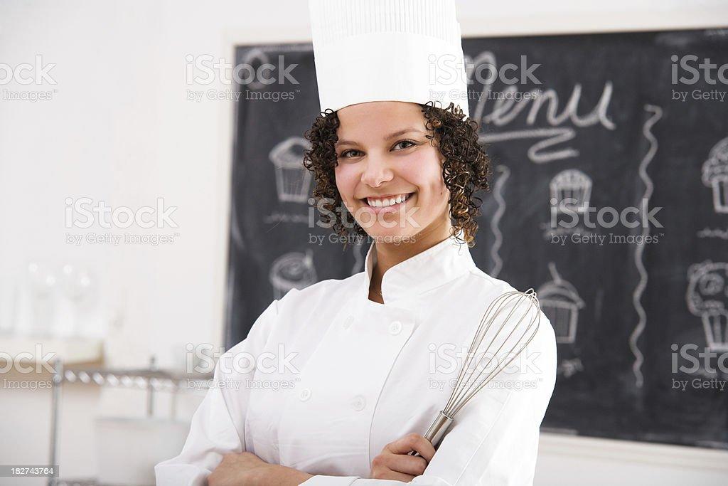 Female Chef  in Front of Menu Board stock photo
