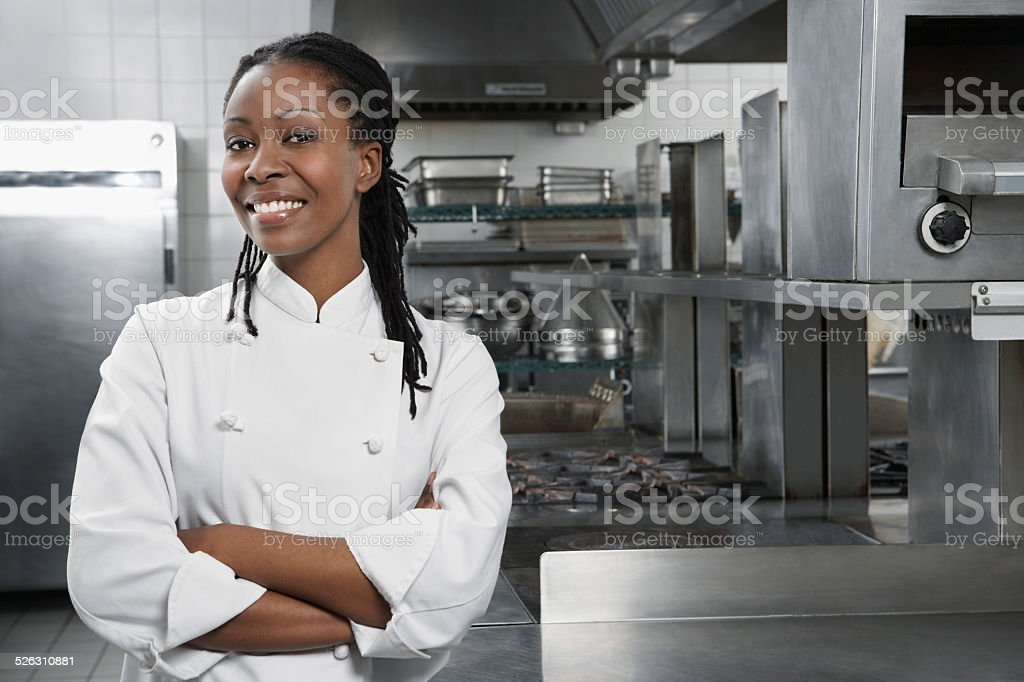 Female Chef In The Kitchen stock photo