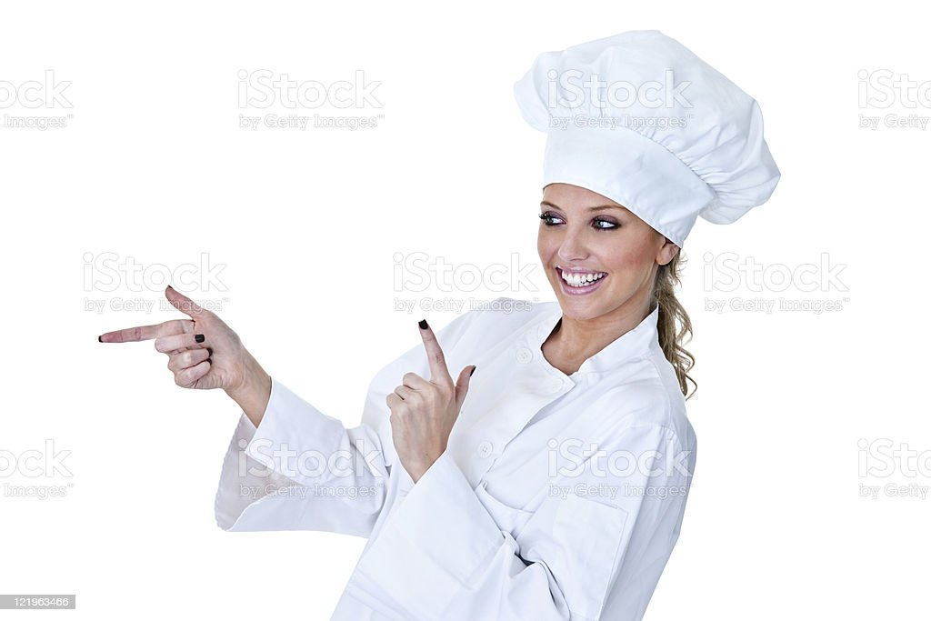 Female chef pointing to copy space royalty-free stock photo