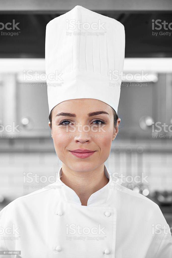 Female chef portrait in restaurant kitchen stock photo