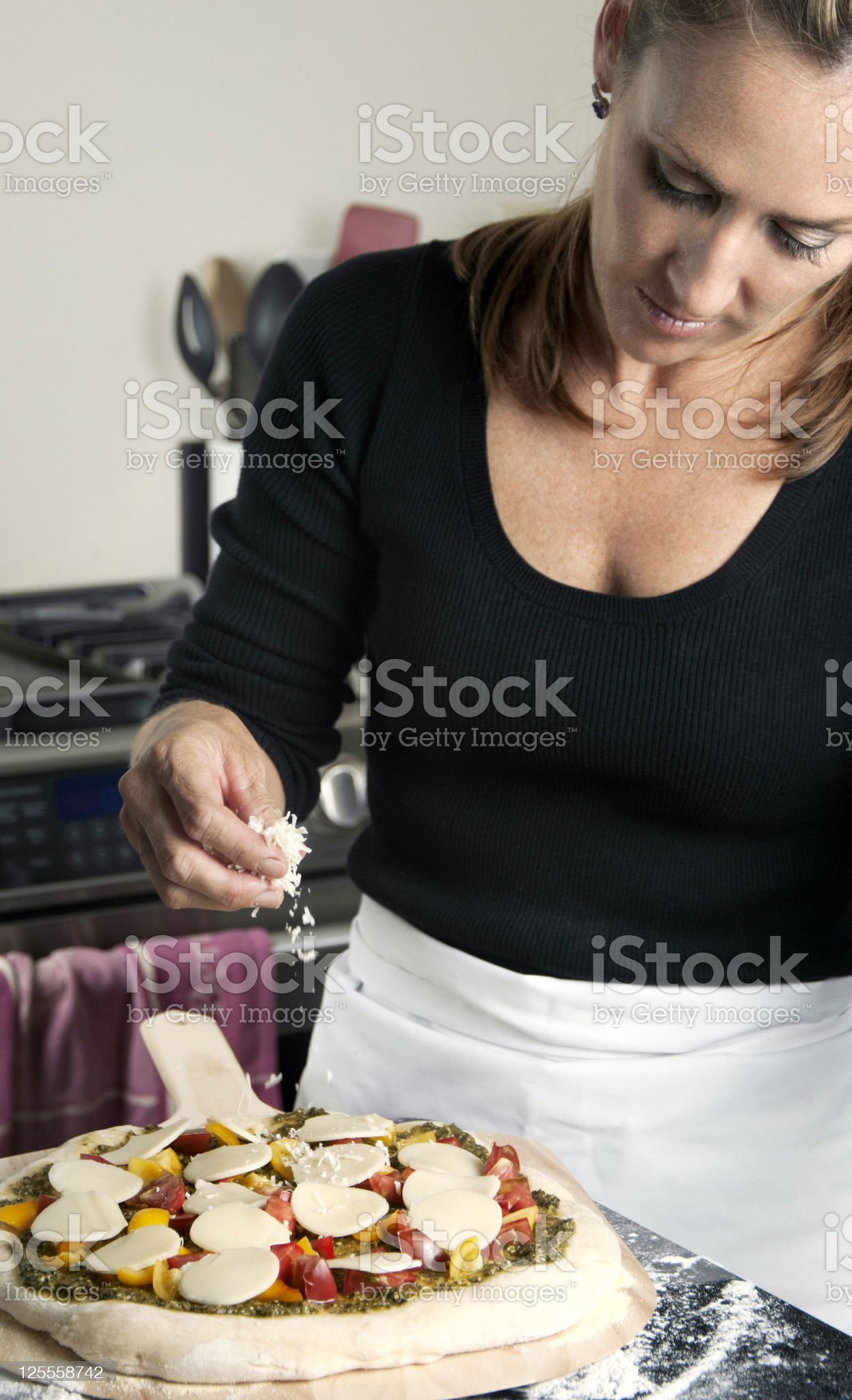 Female Chef Preparing Pizza royalty-free stock photo