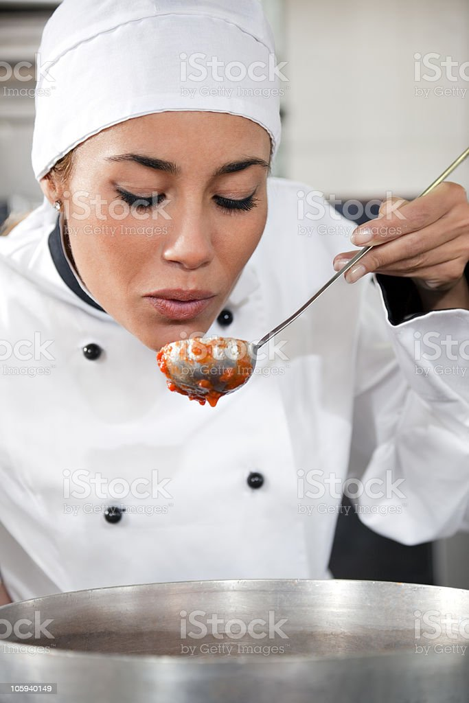 A female chef tasting a sauce  royalty-free stock photo