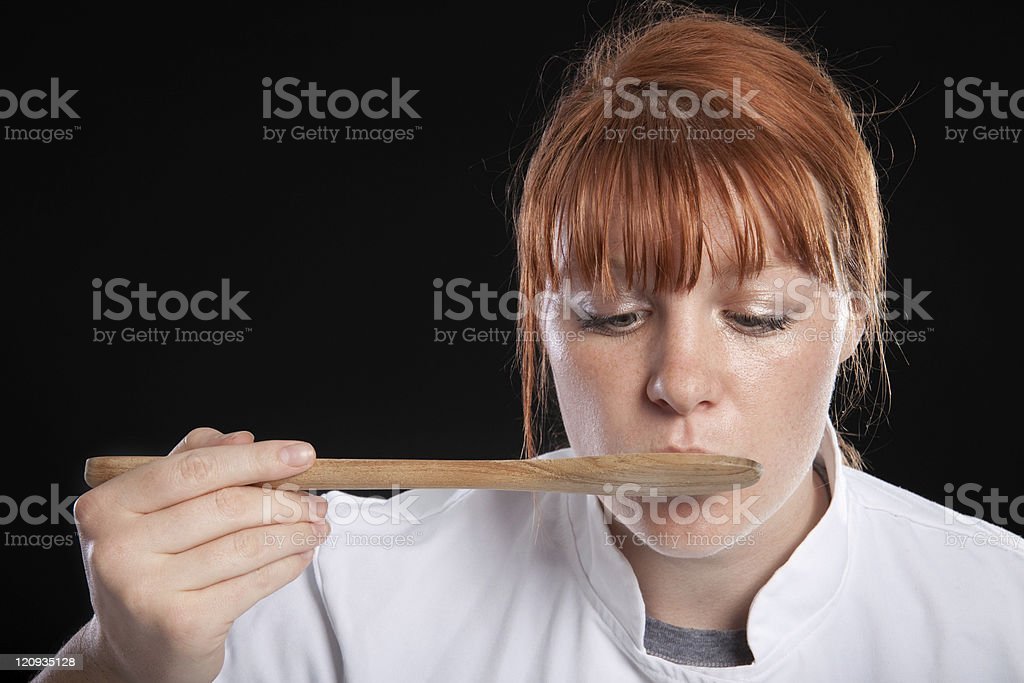 Female Chef Tasting Food royalty-free stock photo