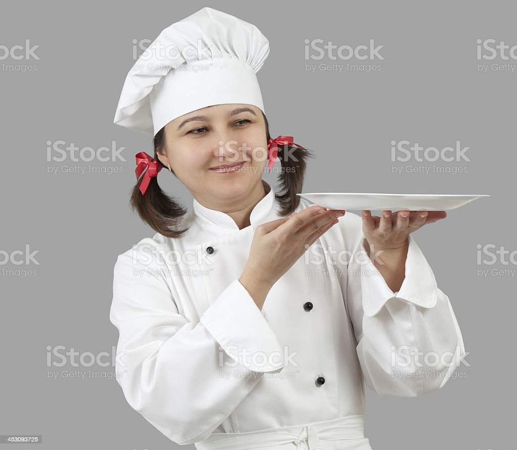Female chef with a tray. royalty-free stock photo
