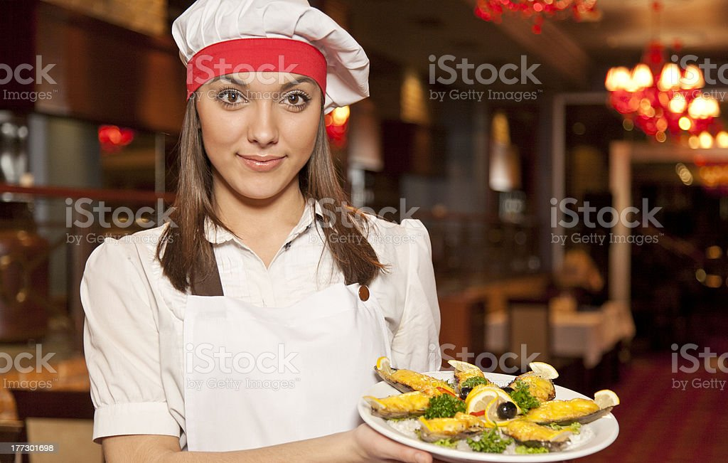 Female chef with food royalty-free stock photo