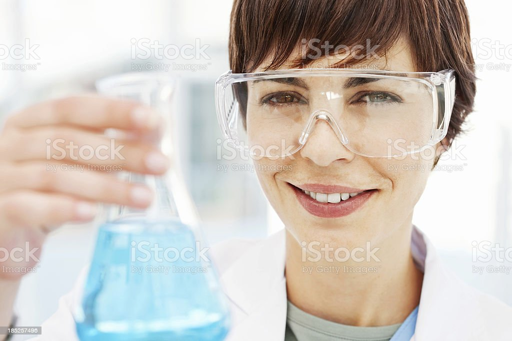 Female Chemist Holding Flask Of Chemical Solution royalty-free stock photo