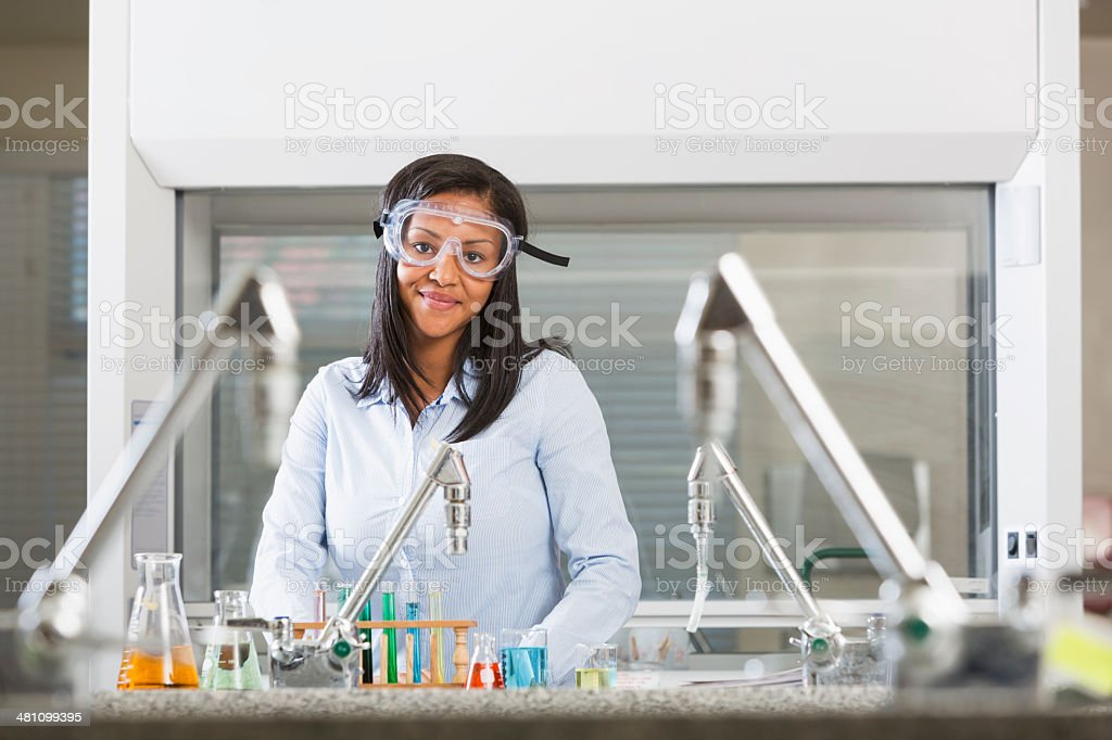 Female chemistry student doing science experiment in lab royalty-free stock photo