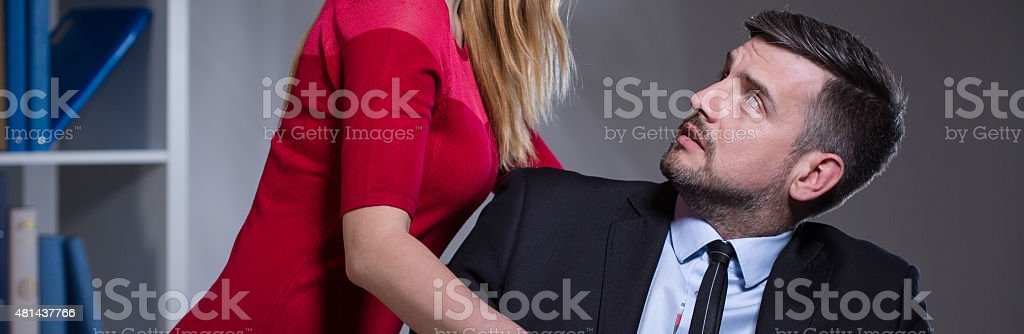 Female chief harassing his worker stock photo